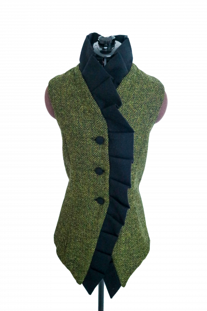 A black and green waistcoat on a mannequin over a white background.